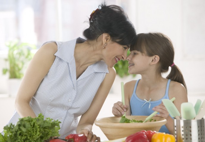 Mother and Daughter Making a Salad